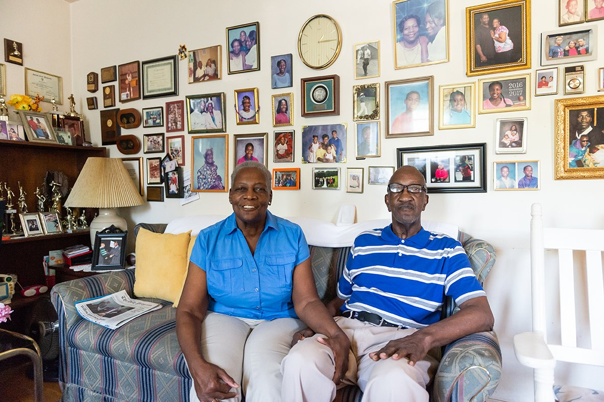 older black couple sitting on couch