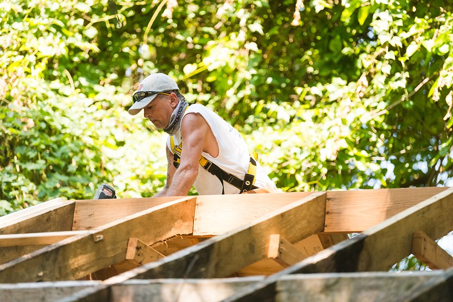 carpenter fixing a roof
