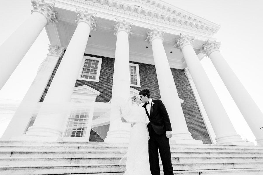 newly wed kissing on steps of uva rotunda