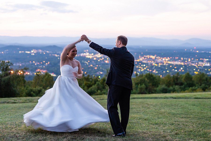 newlyweds dancing at sunset with blue ridge mountains backdrop