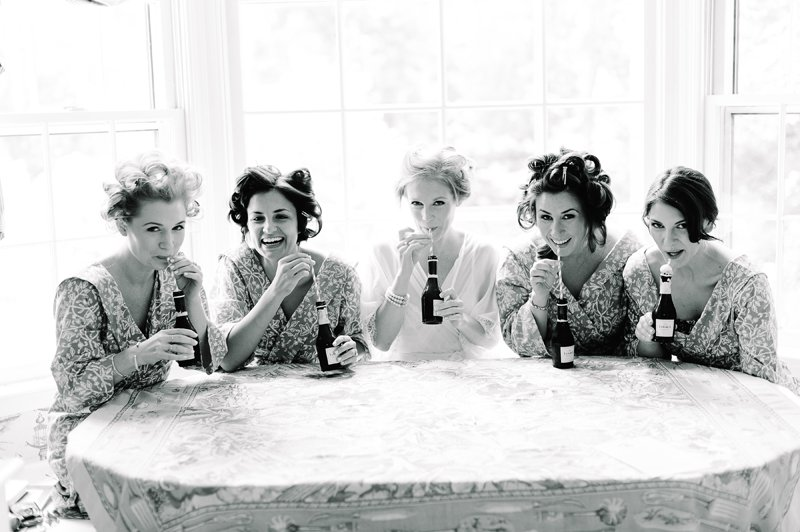 bridesmaids drinking champagne with straws